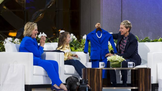 "U.S. Democratic presidential candidate Hillary Clinton laughs as television host Ellen DeGeneres presents 5-year-old presidential expert Macey Hensley with a gift during a taping of ""The Ellen DeGeneres Show"" in New York September 8, 2015. REUTERS/Lucas Jackson"