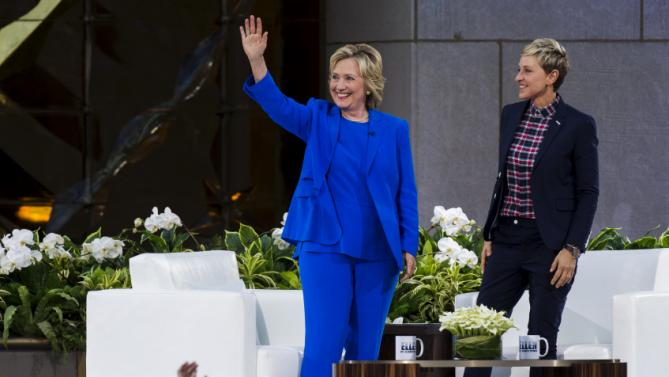 "U.S. Democratic presidential candidate Hillary Clinton stands with television host Ellen DeGeneres during a taping of ""The Ellen DeGeneres Show"" in New York September 8, 2015. REUTERS/Lucas Jackson"