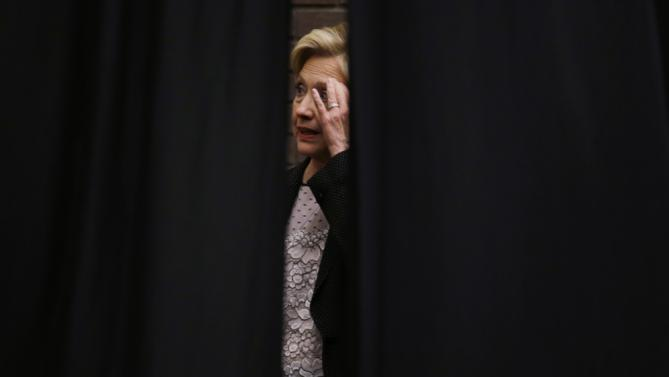 Democratic presidential candidate Hillary Rodham Clinton waits behind a curtain to be introduced at a rally at the University of Wisconsin-Milwaukee, Thursday, Sept. 10, 2015, in Milwaukee. (AP Photo/Morry Gash)