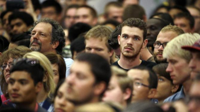 Supporters watch as Democratic presidential candidate Hillary Rodham Clinton speaks at the University of Wisconsin-Milwaukee, Thursday, Sept. 10, 2015, in Milwaukee. (AP Photo/Morry Gash)
