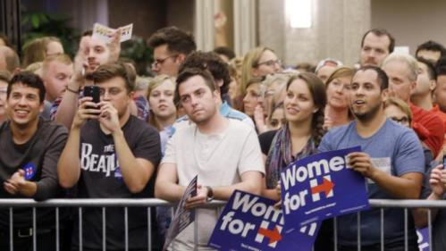 Supporter watch Democratic presidential candidate Hillary Rodham Clinton speak at the University of Wisconsin-Milwaukee, Thursday, Sept. 10, 2015, in Milwaukee. (AP Photo/Morry Gash)