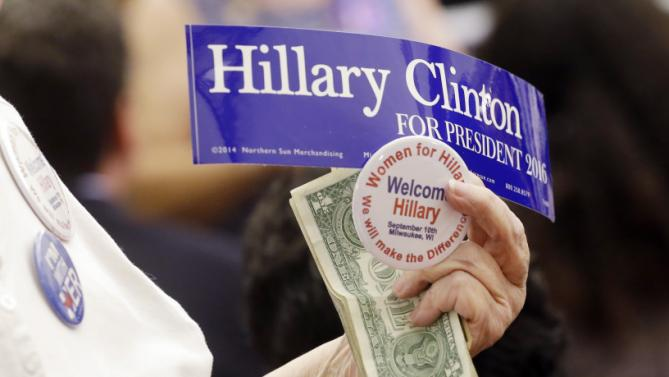 A supporter sells items before Democratic presidential candidate Hillary Rodham Clinton speaks at the University of Wisconsin-Milwaukee, Thursday, Sept. 10, 2015, in Milwaukee. (AP Photo/Morry Gash)
