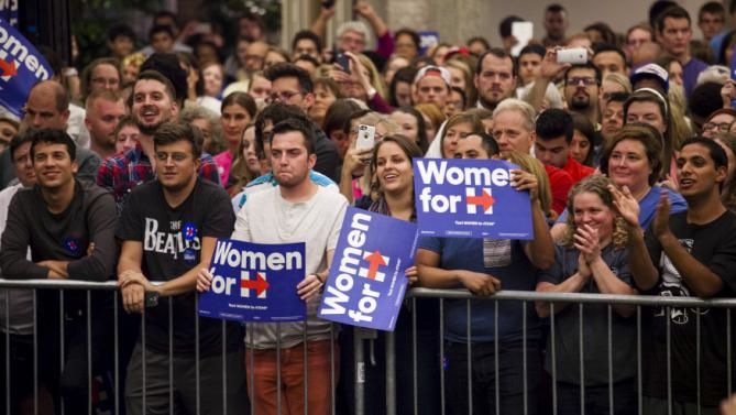 "Supporters listen to Democratic presidential candidate Hillary Clinton speak at a ""Women for Hillary"" meeting in Milwaukee, Wisconsin September 10, 2015. REUTERS/Darren Hauck"