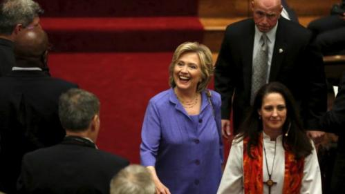 U.S. Democratic presidential candidate Hillary Clinton smiles as she leaves after the Foundry United Methodist Church's bicentennial service in Washington September 13, 2015. REUTERS/Yuri Gripas