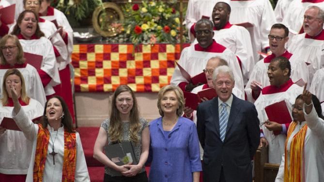 Democratic presidential candidate Hillary Rodham Clinton, her daughter Chelsea, second from left, and husband, former President Bill Clinton, attend the Foundry United Methodist Church for their Bicentennial Homecoming Celebration, in Washington, Sunday, Sept. 13, 2015. During President Bill Clinton's presidency, the Clintons worshipped and participated regularly at Foundry. Also pictured in front of the choir are Rev. Ginger Gaines-Cirelli, left, and Rev. Dawn M. Hand, right. (AP Photo/Molly Riley)