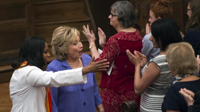 Democratic presidential candidate Hillary Rodham Clinton, with Rev. Dawn M. Hand, left, greets church attendees at the Foundry United Methodist Church for their Bicentennial Homecoming Celebration, in Washington, Sunday, Sept. 13, 2015. During President Bill Clinton's presidency, the Clintons worshipped and participated regularly at Foundry. (AP Photo/Molly Riley)