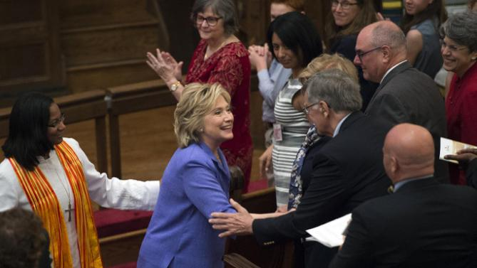 Democratic presidential candidate Hillary Rodham Clinton, with Rev. Dawn M. Hand, left, greets church attendees at the Foundry United Methodist Church, in Washington, Sunday, Sept. 13, 2015. During President Bill Clinton's presidency, the Clintons worshipped and participated regularly at Foundry. (AP Photo/Molly Riley)