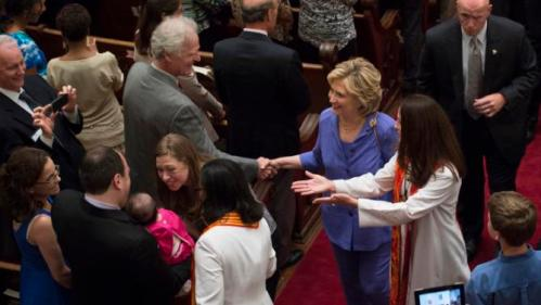 Democratic presidential candidate Hillary Rodham Clinton and her daughter, Chelsea, greet congregants after attending the Foundry United Methodist Church for their Bicentennial Homecoming Celebration, in Washington, Sunday, Sept. 13, 2015. During President Bill Clinton's presidency, the Clintons worshipped and participated regularly at Foundry. The Revs. Dawn M. Hand and Ginger Gaines-Cirelli, with hands outstretched, stand by, dressed in robes. (AP Photo/Molly Riley)