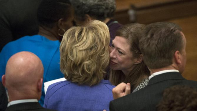 Chelsea Clinton, center right, kisses her mother, Democratic presidential candidate Hillary Rodham Clinton, as they attend service at Foundry United Methodist Church for their Bicentennial Homecoming Celebration, in Washington, Sunday, Sept. 13, 2015. During President Bill Clinton's presidency, the Clintons worshipped and participated regularly at Foundry. (AP Photo/Molly Riley)