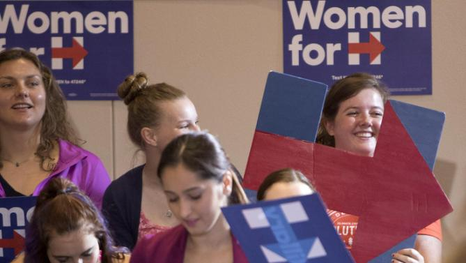 A supporter holds a hand-made sign for Democratic presidential candidate Hillary Rodham Clinton during an organizing event at the University of Northern Iowa, Monday, Sept. 14, 2015, in Cedar Falls, Iowa. (AP Photo/Scott Morgan)