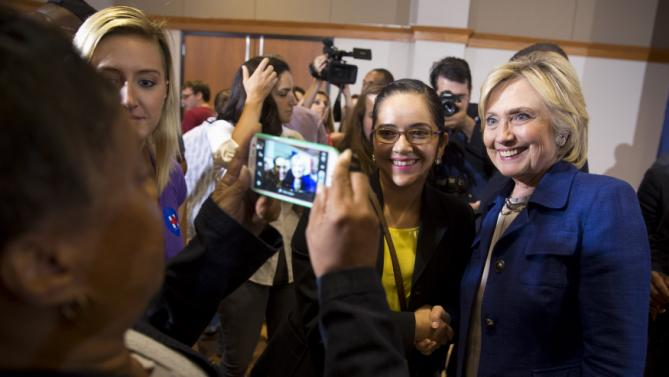 Democratic presidential candidate Hillary Rodham Clinton takes pictures with supporters during an organizing event at the University of Northern Iowa, Monday, Sept. 14, 2015, in Cedar Falls, Iowa. (AP Photo/Scott Morgan)