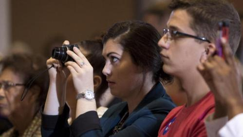 A supporter takes a photo as Democratic presidential candidate Hillary Rodham Clinton as she speaks during an organizing event at the University of Northern Iowa, Monday, Sept. 14, 2015, in Cedar Falls, Iowa. (AP Photo/Scott Morgan)