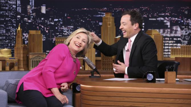 U.S. Democratic presidential candidate Hillary Clinton has her hair pulled by host Jimmy Fallon (R) during an interview on the Tonight Show in New York in this image released on September 16, 2015.  REUTERS/Douglas Gorenstein/NBC/Handout   TPX IMAGES OF THE DAY  NO SALES. NO ARCHIVES. FOR EDITORIAL USE ONLY. NOT FOR SALE FOR MARKETING OR ADVERTISING CAMPAIGNS. THIS IMAGE HAS BEEN SUPPLIED BY A THIRD PARTY. IT IS DISTRIBUTED, EXACTLY AS RECEIVED BY REUTERS, AS A SERVICE TO CLIENTS