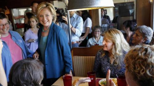 Democratic presidential candidate Hillary Rodham Clinton talks with customers during a campaign stop at the Union Diner, Thursday, Sept. 17, 2015, in Laconia, N.H. (AP Photo/Jim Cole)