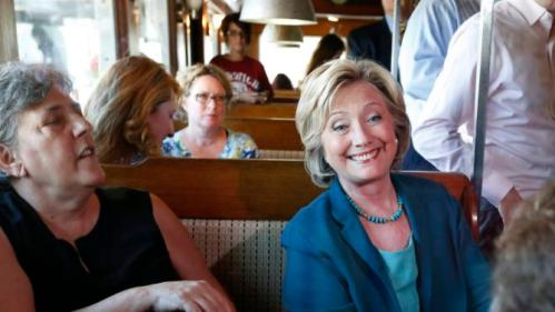 Democratic presidential candidate Hillary Rodham Clinton speaks with customers during a campaign stop at the Union Diner Thursday, Sept. 17, 2015, in Laconia, N.H. (AP Photo/Jim Cole)