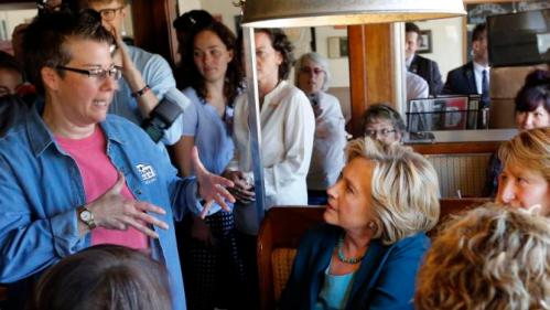 Democratic presidential candidate Hillary Rodham Clinton, right, listens to Rose Pucci during a campaign stop at the Union Diner Thursday, Sept. 17, 2015, in Laconia, N.H. (AP Photo/Jim Cole)