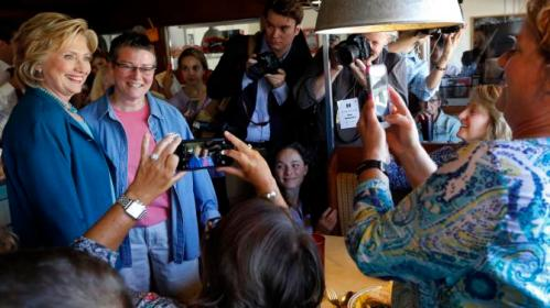 Democratic presidential candidate Hillary Rodham Clinton poses for a photo during a campaign stop at the Union Diner Thursday, Sept. 17, 2015, in Laconia, N.H. (AP Photo/Jim Cole)