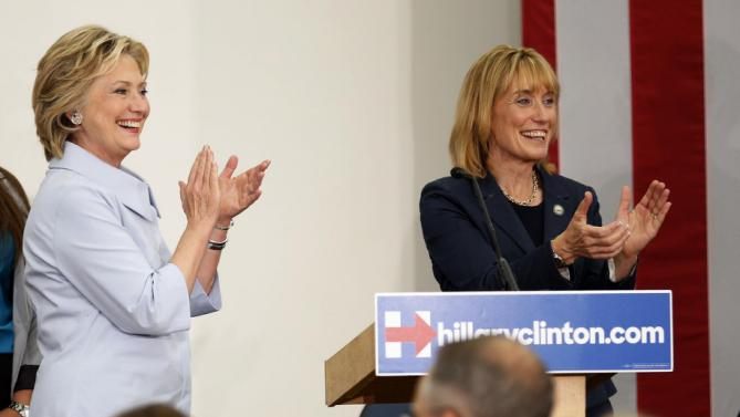 Democratic presidential candidate Hillary Rodham Clinton, accompanied by New Hampshire Gov. Maggie Hassan, arrive at the University of New Hampshire, Friday, Sept. 18, 2015, in Durham, N.H. (AP Photo/Jim Cole)