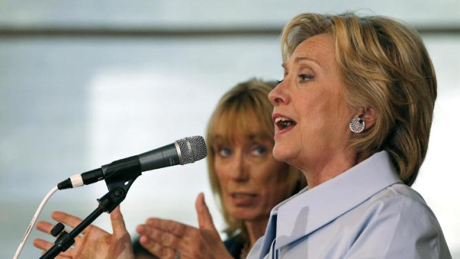 Democratic presidential candidate Hillary Rodham Clinton, accompanied by New Hampshire Gov. Maggie Hassan, speaks to an overflow crowd during a campaign stop at the University of New Hampshire, Friday, Sept. 18, 2015, in Durham, N.H. (AP Photo/Jim Cole)