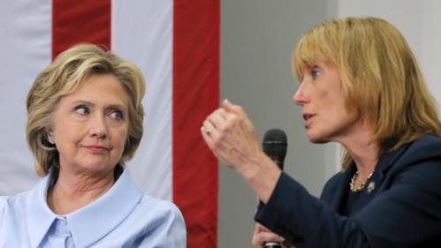 U.S. Democratic presidential candidate Hillary Clinton listens as New Hampshire Governor Maggie Hassan (R) answers a question from the audience at a campaign community forum on college affordability in Durham, New Hampshire September 18, 2015. Governor Hassan announced her endorsement of Clinton at the event. REUTERS/Brian Snyder
