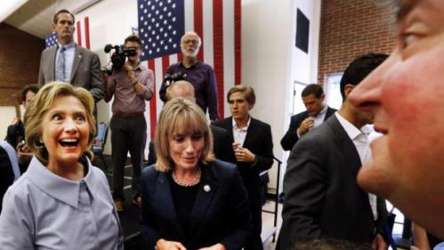 Democratic presidential candidate Hillary Rodham Clinton, left, accompanied by New Hampshire Gov. Maggie Hassan, center, greets voters during a campaign stop at the University of New Hampshire, Friday, Sept. 18, 2015, in Durham, N.H. (AP Photo/Jim Cole)