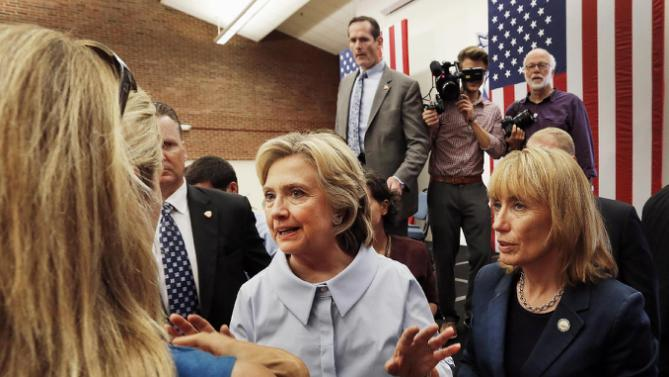 Democratic presidential candidate Hillary Rodham Clinton, accompanied by New Hampshire Gov. Maggie Hassan, talks with students during a campaign stop at the University of New Hampshire, Friday, Sept. 18, 2015, in Durham, N.H. (AP Photo/Jim Cole)