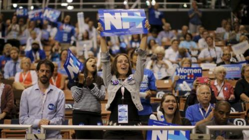 Supporters cheer while U.S. Democratic presidential candidate Hillary Clinton speaks at the New Hampshire Democratic Party State Convention in Manchester, New Hampshire September 19, 2015. REUTERS/Brian Snyder