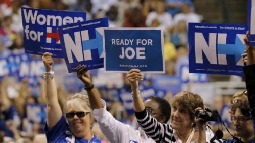 "A woman holds up a sign reading ""Ready for Joe,"" referring to U.S. Vice President Joe Biden, while U.S. Democratic presidential candidate Hillary Clinton speaks at the New Hampshire Democratic Party State Convention in Manchester, New Hampshire September 19, 2015. REUTERS/Brian Snyder"