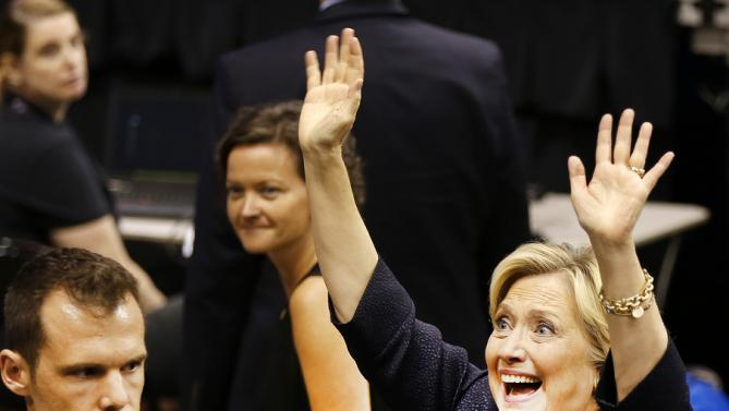 Democratic presidential candidate Hillary Rodham Clinton waves to supporters after speaking at the state's annual Democratic convention Saturday, Sept. 19, 2015, in Manchester, N.H. (AP Photo/Jim Cole)
