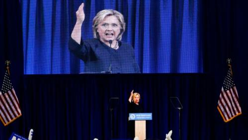 Supporters cheer as Democratic presidential candidate Hillary Rodham Clinton speaks during the state's annual Democratic convention Saturday, Sept. 19, 2015, in Manchester, N.H. (AP Photo/Jim Cole)