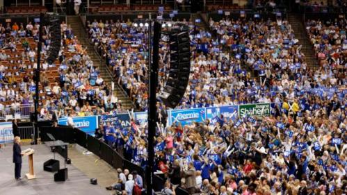 Democratic presidential candidate Hillary Rodham Clinton speaks to several thousand people during the state's annual Democratic convention Saturday, Sept. 19, 2015, in Manchester,NH (AP Photo/Jim Cole)