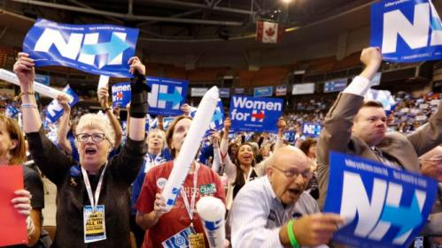 Supporters of Democratic presidential candidate Hillary Rodham Clinton cheer as she arrives at the state's annual Democratic convention Saturday, Sept. 19, 2015, in Manchester, N.H. (AP Photo/Jim Cole)