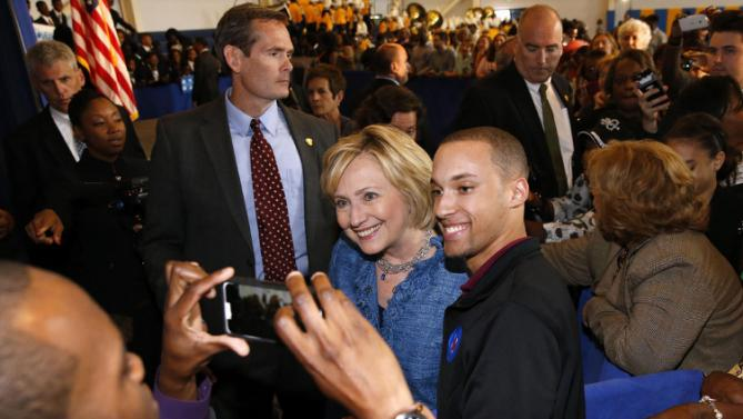 Democratic presidential candidate Hillary Rodham Clinton takes a photo with a supporter during a campaign stop in Baton Rouge, La., Monday, Sept. 21, 2015. (AP Photo/Jonathan Bachman)