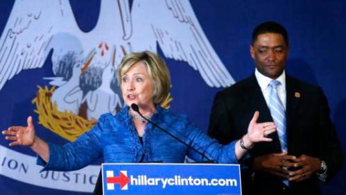 Democratic presidential candidate Hillary Rodham Clinton accompanied by Rep. Cedric Richmond, D-La., speaks during a campaign stop in Baton Rouge, La., Monday, Sept. 21, 2015. (AP Photo/Jonathan Bachman)