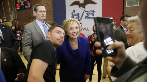 Democratic presidential candidate Hillary Rodham Clinton poses for a photo with an audience member following a community forum on healthcare, Tuesday, Sept. 22, 2015, at Moulton Elementary School in Des Moines, Iowa. (AP Photo/Charlie Neibergall)