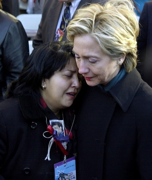 US Senator Hillary Rodham Clinton (R) consoles Maren Sarkar (L) 28 October, 2001, after the World Trade Center Family Memorial Service in New York. Several thousand people attended the memorial service near ground zero of the attack. AFP PHOTO Stan HONDA (Photo credit should read STAN HONDA/AFP/Getty Images)