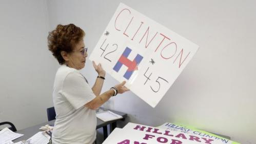 Volunteer Patti Lynn of Tamrac, Fla., sorts through campaign signs before an event by Democratic presidential candidate Hillary Rodham Clinton, Friday, Oct. 2, 2015, at Broward College in Davie, Fla. (AP Photo/Lynne Sladky)