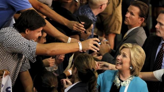 U.S. Democratic presidential candidate Hillary Clinton greets guests after her 'Grassroots' organizational event at Broward State College in Davie, Florida, October 2, 2015. REUTERS/Joe Skipper