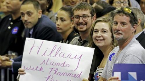 A guest holds a sign before U.S. Democratic presidential candidate Hillary Clinton began a 'Grassroots' organizational event at Broward State College in Davie, Florida, October 2, 2015. REUTERS/Joe Skipper