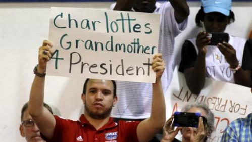 A guest holds a sign making a reference to U.S. Democratic presidential candidate Hillary Clinton's granddaughter as she holds a 'Grassroots' organizational event at Broward State College in Davie, Florida, October 2, 2015. REUTERS/Joe Skipper