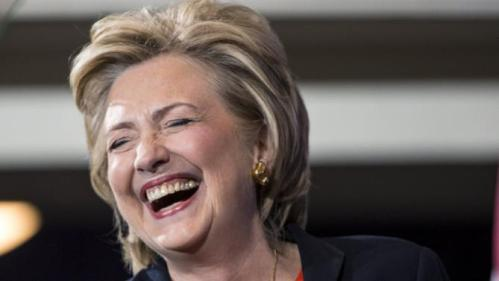 Democratic presidential candidate Hillary Clinton laughs before speaking to supporters at the Human Rights Campaign Breakfast in Washington, October 3, 2015. REUTERS/Joshua Roberts