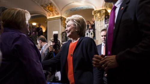 Democratic presidential candidate Hillary Clinton greets supporters after speaking at the Human Rights Campaign Breakfast in Washington, October 3, 2015. REUTERS/Joshua Roberts