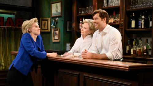 "In this Saturday, Oct. 3, 2015, photo, provided by NBC, Kate McKinnon, left, portraying Hillary Rodham Clinton, and Hillary Rodham Clinton, center, portraying Val, and Taran Killam appear during the ""Bar Talk"" sketch on ""Saturday Night Live,"" in New York. Most political candidates play themselves on ""SNL,"" often for just a cameo in a sketch or to declare the show's famous tag line, ""Live from New York, it's Saturday night!"" Seldom do they play a character in a sketch, as did Clinton. (Dana Edelson/NBC via AP)"