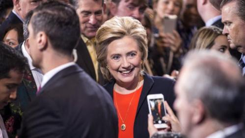 Democratic presidential candidate Hillary Clinton has a picture taken by a supporter after speaking at the Human Rights Campaign Breakfast in Washington, October 3, 2015. REUTERS/Joshua Roberts
