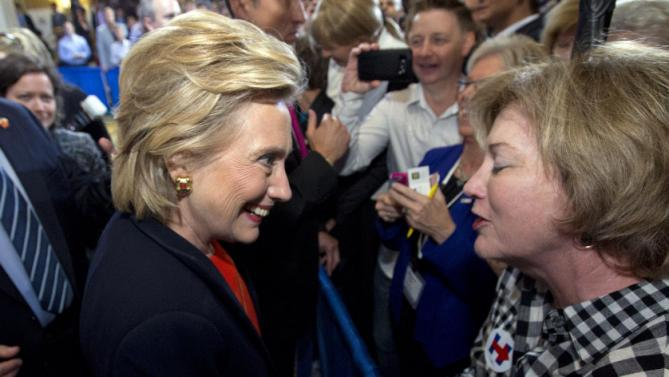 Democratic presidential candidate Hillary Rodham Clinton shake hands with supporters after speaking to the Human Rights Campaign in Washington, Saturday, Oct. 3, 2015. ( AP Photo/Jose Luis Magana)