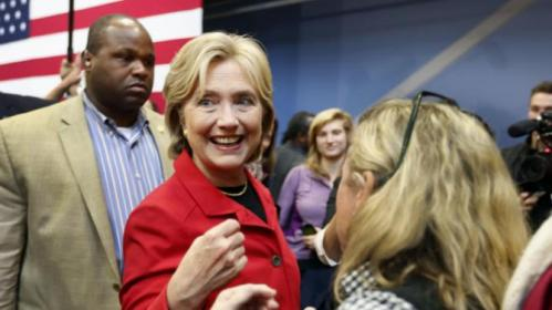 Democratic presidential candidate Hillary Rodham Clinton greets voters during a campaign stop at the Manchester Community College, Monday, Oct. 5, 2015, in Manchester, N.H. (AP Photo/Jim Cole)