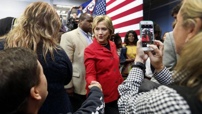 Democratic presidential candidate Hillary Rodham Clinton campaigns during a campaign stop at the Manchester Community College,  Monday, Oct. 5, 2015, in Manchester,NH (AP Photo/Jim Cole)