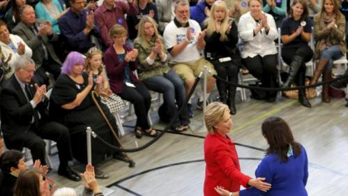 U.S. Democratic presidential candidate Hillary Clinton is joined by Nicole Hockley (R), mother of Newtown shooting victim Dylan, at a campaign town hall meeting in Manchester, New Hampshire October 5, 2015. Clinton spoke out forcefully in favor of new gun control measures after a shooting last week on the campus of Umpqua Community College in Roseburg, Oregon, which killed nine people and wounded another nine. REUTERS/Brian Snyder