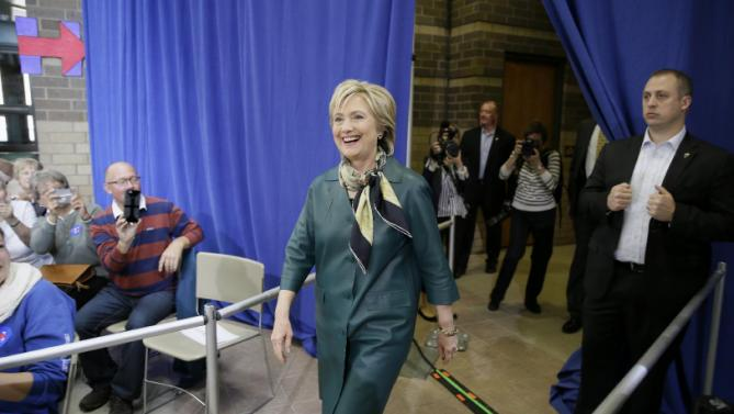 Democratic presidential candidate Hillary Rodham Clinton smiles as she arrives to speak at a community forum, Tuesday, Oct. 6, 2015, in Davenport, Iowa. (AP Photo/Charlie Neibergall)