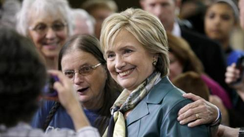 Democratic presidential candidate Hillary Rodham Clinton poses for a photo with an audience member following a community forum, Tuesday, Oct. 6, 2015, in Davenport, Iowa. (AP Photo/Charlie Neibergall)